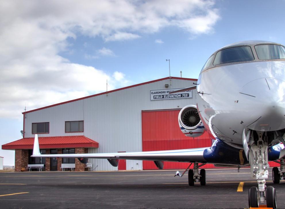 man standing beside plane